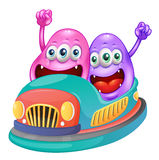 Monsters riding on a bumpcar Royalty Free Stock Photo