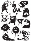 Monsters silhouettes. Silhouettes of cute doodle monsters-bacteria Stock Image