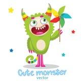 Monstersuniversiteit De Mascotte van het beeldverhaalmonster Groen Monster met Kleurenvuurrad Stock Foto