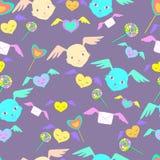 Monstres fantastiques, visages mignons avec des ailes, sucreries d'arc-en-ciel, smil Image stock