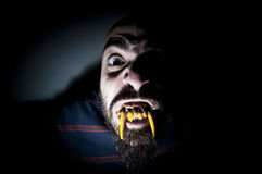 Monstrous man with long teeth Royalty Free Stock Photography