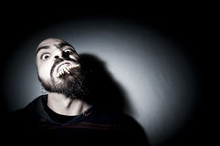 Monstrous man with long teeth Stock Image