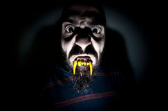 Monstrous man with long teeth Stock Photography