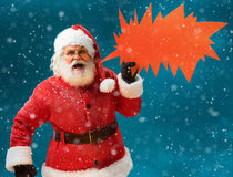 Monstrous Santa Claus showing red sign speech bubble banner, looking unhappy and angry Stock Photo