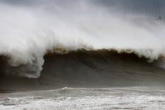 Monstrous Tsunami wave during a storm. A big stunami wave splashing near a beach shore stock photography