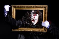 Monstruo con el marco de la foto de la imagen Fotografía de archivo