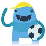 Monstruo del fútbol que sostiene una bola Imagen de archivo libre de regalías