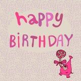 Monstruo rosado con feliz cumpleaños del caramelo Fotografía de archivo