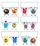 monstruos coloridos con los carteles Imagen de archivo libre de regalías
