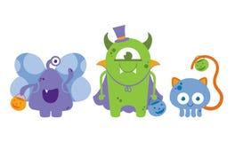 Monstruos lindos en disfraces de Halloween imagen de archivo libre de regalías