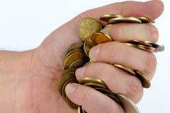 Montão das moedas na mão Foto de Stock