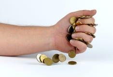 Montão das moedas na mão Fotografia de Stock Royalty Free