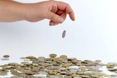 Montão das moedas na mão Fotografia de Stock