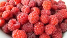 Montão de framboesas doces vermelhas Foto de Stock