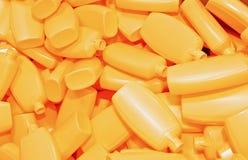 Montão de frascos plásticos amarelos Imagens de Stock Royalty Free