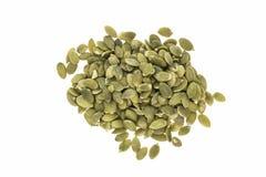 Montão de sementes de abóbora hulled, no branco Imagens de Stock Royalty Free