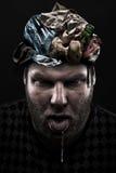 Montão do lixo dentro da cabeça parva do homem Imagem de Stock Royalty Free