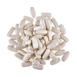 Montão dos comprimidos nutritivos do suplemento isolados no branco Imagens de Stock Royalty Free