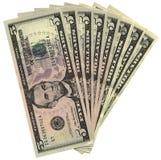 Montón de cinco dólares aislados, abundancia de los ahorros Imágenes de archivo libres de regalías