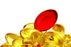 Montón de las cápsulas de la vitamina. Foto de archivo libre de regalías