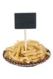 Montón de las pastas en una placa, con un indicador para su texto Fotografía de archivo libre de regalías