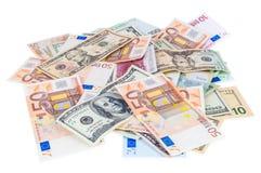 Montón de los billetes de banco del dólar y del euro Fotos de archivo