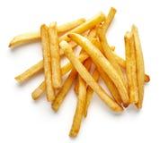 Montón de patatas fritas en blanco, desde arriba foto de archivo libre de regalías