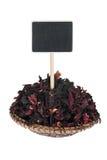 Montón del hibisco en una placa, con un indicador para su texto Imagen de archivo