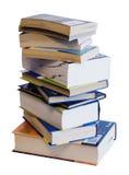 Montón vertical de los libros coloridos aislados en blanco Fotografía de archivo libre de regalías
