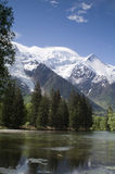 Mont Blanc. View of Mont Blanc mountain range reflected in lake in Chamonix - portrait orientation Stock Photo