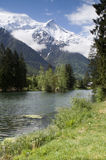 Mont Blanc. View of Mont Blanc mountain range reflected in lake in Chamonix - portrait orientation Stock Photography