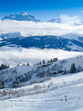 Mont blanc above the clouds. Mont Blanc above clouds , ski piste. Extensive powder snow. French alps Stock Photo
