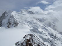 Mont Blanc behind the clouds Stock Image