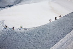 Mont Blanc, Chamonix, French Alps. France. - tourists climbing u Stock Photo