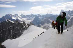 Mont Blanc. CIRCA JULY 2012 - MONT BLANC: climbers on tours in the Mont Blanc high mountain range near Auigulle du Midi, France Stock Images