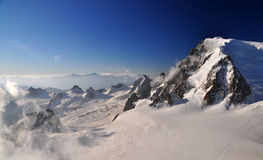 Mont Blanc du Tacul. (4248 m) is a mountain in the Mont Blanc massif of the French Alps situated midway between the Aiguille du Midi and Mont Blanc Royalty Free Stock Photos