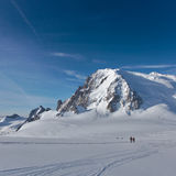 Mont Blanc du Tacul and climbers. On the glacier Stock Photo