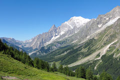 Mont Blanc and Ferret Valley landscape. Mont Blanc and Auiguille du midi from  Ferret Valley near Courmayeur . Italy Stock Photo