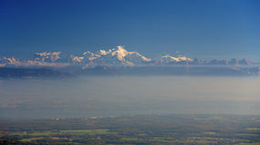 Mont Blanc. In France on a windy day taken from across Lake Geneva on the Jura Mountain range Royalty Free Stock Photography