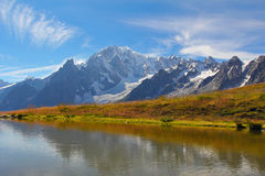 Mont Blanc glacier reflected. Mont Blanc panorama  reflected in high mountain pond . Courmayeur Royalty Free Stock Photo