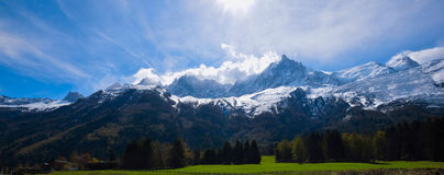 Mont Blanc Mountain covered with snow in spring. Amazing panorama with snow avalanche of French Alps in the spring. Mont Blanc Mountain covered with snow in Royalty Free Stock Image