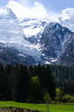 Mont Blanc Mountain covered with snow in spring. Amazing panorama with snow avalanche of French Alps in the spring. Mont Blanc Mountain covered with snow in Royalty Free Stock Photography