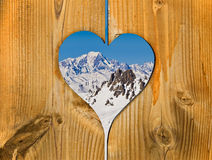 The Mont-Blanc mountain covered with snow viewed through a wooden heart Stock Photo