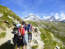 MONT BLANC, Mountaineering with backpacks on expedition to highest Alps peak. Of high rocks. Sport and active life concept royalty free stock images