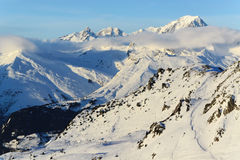 Mont Blanc and ski slopes. Mont Blanc (French) or Monte Bianco (Italian), meaning White Mountain, is the highest mountain in the Alps, Western Europe, and the Royalty Free Stock Images