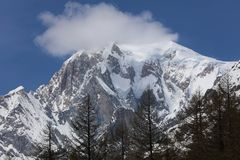 Mont Blanc Summit with clouds from Courmayeur Stock Photos