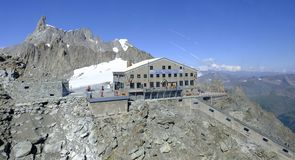 Mont Blanc. The Torino Hut operates as a mountain refuge with horizontal tunnel and a vertical lift. Italy stock photo