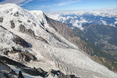 The Mont Blanc and upper part of Bossons glacier, France Stock Photos