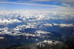 Mont Blanc. The Mont Blanc is visible in the center of this aerial photography. The glacier is also visible at the center-left of the image Royalty Free Stock Images
