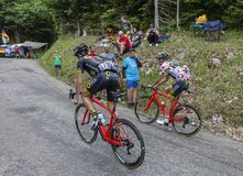 Mont du Chat, France - July 9, 2017: Two cyclists, Angelo Tulik and the Polka Dot Jersey, Lilian Calmejane of Direct Energie Team royalty free stock photography